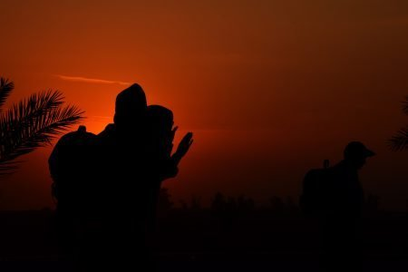 Iraq dawn landscape with silhouettes of morning prayer.