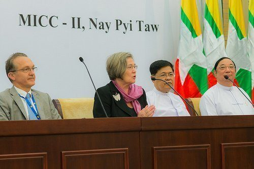 Clare pictured in Myanmar with representatives of the former government, 2014