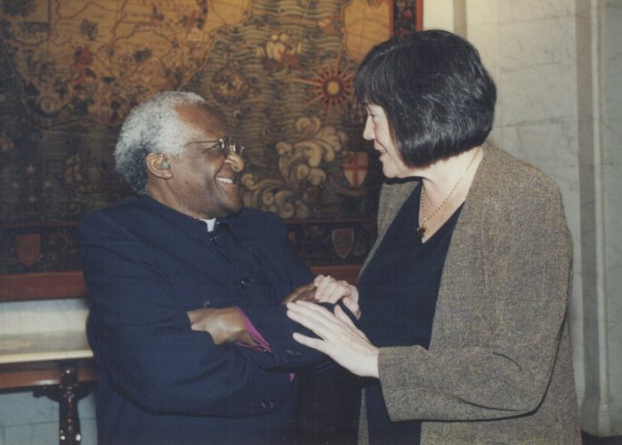Clare with Archbishop Desmond Tutu at the South African Embassy, London, 2000.