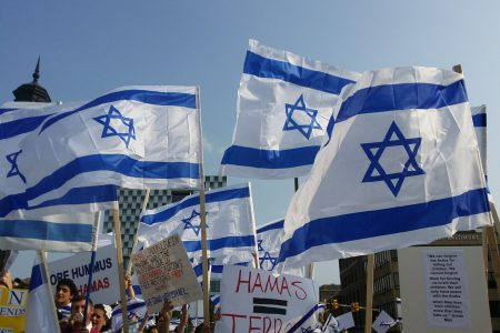 Israeli flags at protest.