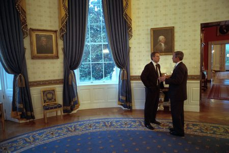 Blair and Bush speaking in the oval office.